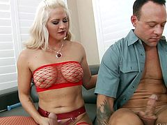 Big titty blonde Holly Heart in red fishnet stockings and bra plays with her strap-on dildo on the couch and then takes care of horny guy. She cant wait tot make her fake cock disappear in his asshole