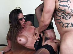 Busty woman in lingerie is willing to fuck her boss in the office