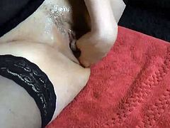 Hairy pussy fisting in black stockings