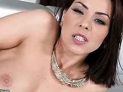 Brunette Cindy Hope has fire in her eyes as she plays with herself