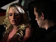 Stormy Daniels with big hooters having oral fun with horny dude