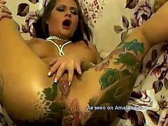 I don't know this chick's name, but she has a lot of nice on her. Nice tattoos, nice ass, nice tits, nice pussy and a really nice collection of toys for fun. She starts the show by bending over and giving her anus the finger. She gets the toys and pleasures both of her holes for her man's enjoyment.