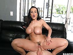 Brunette Lisa Ann with massive boobs spends time sucking guys erect tool