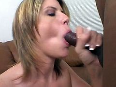 Chubby pale blond head called Lisa Sparxxx provides black dude with footjob