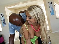 Cute blonde Madelyn Monroe in fishnet bodystocking shows her natural tits and sexy ass to black guy Lexington Steele in the garden. Naughty chick loves doing it outdoor.