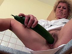 Granny fucks herself with a cucumber!