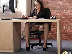 Secretary shows off her shaved pussy in an upskirt clip