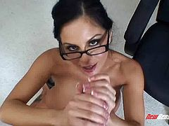 Beautiful secretary in glasses giving a titjob and blowjob