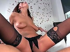 Whitney Westgate is a brunette slut in sexy lingerie. Her boobs are squeezed by her lover and then the guys dick makes contact with her pussy through her crotch less panties. Blow job