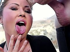Kianna Dior is a busty Asian lady that is receiving a lot of cum while giving a blow job. She does it outside with her hair flowing in the wind.