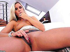 Blonde Dido Angel gives a closeup view of her bush while masturbating