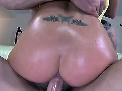 Rachel Roxxx lets her boobs fall out of her top. We find out that she has nipple piercings on them. Then she bends over and does it doggy style.