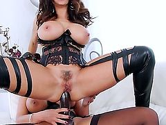 Phoenix Marie and Ava Addams are a couple of lesbians that are trying on a strap on for size. They are having anal sex with it. Check out their large boobs.