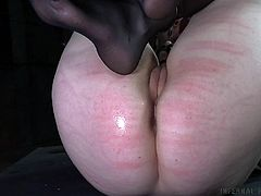 Sierra is tied up and gagged, so the whipping of her ass doesn't produce her pained cries, as loudly as they would be otherwise. She gets whipped pretty hard with that rod, but she gets some pleasure to make up for it a little later, by way of her executor fingering and dildo fucking her pussy.