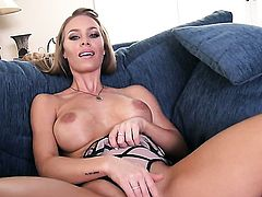 Nicole Aniston with big boobs and trimmed cunt does striptease before she sticks her fingers in her bush
