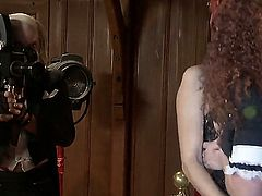 A couple of redhead whores are close up to each other and are making a parody scene. They place their tongues on each others pussies and they start licking.