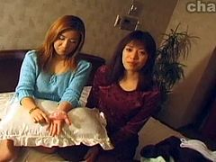 Two asian babes get a facial cum bath