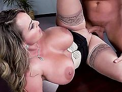 Holly Halston is with her boss. He has an attitude problem. He keeps staring at her tits. She fixes it by revealing them to him and fucking him.