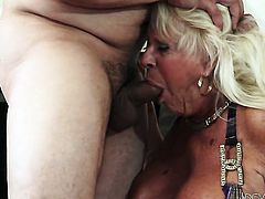 Mandi McGraw with huge tits lets Anthony Rosano put his boner in her mouth