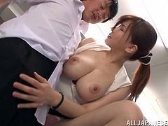 She pulls out her massive boobs for her student. They are alone together after class, so she grabs his hard cock and gives it a tug. They kiss and he buries his face in between her massive tits. He is so lucky.