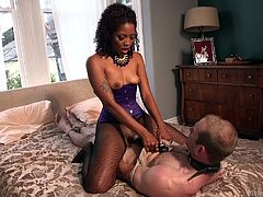 Lotus Lain takes control of this man, tying his neck and hands, making him her sex slave. Sitting on him, ebony takes his cock hard and puts it in her vagina, riding him, and letting him know that she dominates.
