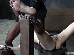 Odette Delacroix is chained to a bench so tight, that her body movement was completely restricted. In that vulnerable position her pussy and mouth were fucked badly, but she enjoyed each and every second of this painful fuck session.