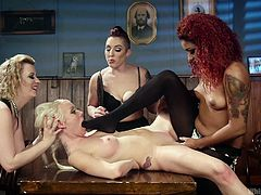 Three mature lesbian mistresses were really happy after getting a cooperative slave. They brutally spanked her ass, till it turns red and fucked her pussy with a huge dildo. She licked her mistres's feet to please them and the complete session has lot of kinky activities.
