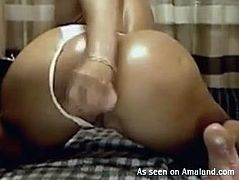 This hoe has so much booty and she loves to fuck her ass with her dildo