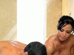 Tanned and tattooed brunette masseuse jerks off soapy dude's cock
