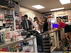 Busty blonde Lexi Lowe gets gangbanged and assfucked in adult video store by many black guys.
