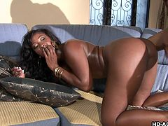 She sucks on her man's hard black cock seductively. This Kingston milf climbs on that giant dick and rides it reverse cowgirl. She is ready for more hot action. After getting her twat licked, her man shoves his black dick inside her deeper. The Ebony slut doesn't want it to end.