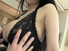 Hitomi has a massive pair of Asian melons. She shows them off and lets me touch. How good it feels to have my cock in between her gigantic sweater puppies. Her boobs are so massive, that they entirely engulf my dick.