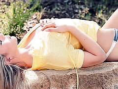 Sophia Knight rubs her pink pussy in nature