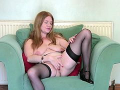 Lily does not have a stiff cock to play with, but hopefully this solo video will get some meat coming her way, or should I say cumming her way. She gets undressed and starts with her luscious tits, before moving her hand downward.