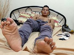 This smooth slim Asian twink loves the smell of his socks and shoes after a long day at work. Hes horny for the sweet aroma of his sweaty feet, so he lays on the bed and starts his foot fetish solo action. Once Joshua strips naked he rubs the head of his hard cock on his soles, making himself moan. Joshua is really getting turned on by his own feet as he strokes his cock until he blows his cum load all over them.