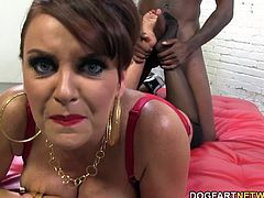 The legendary cougar has some young black cock worship those long, smooth legs that are covered in stockings. Her feet are getting fucked by a big black cock.