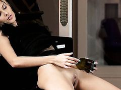With hairless twat is totally naked and plays with her hole non-stop
