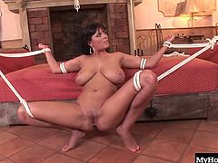 Sexy brunette with big boobs, Jasmine Black, is completely tied up and at her mans mercy in this hot BDSMthemed sex session from Explicit Empires Dangling Delights, getting her holes pounded out as her breasts jiggle, and earning a facial cumshot.