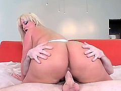 Julie Cash is a blonde with a huge ass. She is placing it on top of her lover and her pussy slides on his cock. It is so huge it eclipses the whole screen.