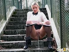Cardigan and skirt on a public pissing girl