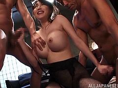 Naughty Miki enjoys the company of three horny men. She's paying attention to each of them, sucking their cocks, while exposing her playful big boobs. Those kinky fishnet stokings she's wearing, are a huge turn on. Watch her fucked hard!