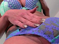 Stunning Eva Paradis, reaches down into her panties and pulls out her tasty lady meat. This nasty slut is rock hard and stroking furiously. It looks like soon, this alluring shemale will be shooting loads of thick sperm all over the bed.