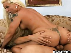 Blonde Serena Marcus with gigantic jugs and trimmed bush spends her sexual energy alone with the help of dildo in anal solo action