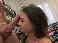 This fresh beautiful model has trouble sucking a dick, because it is too big for her mouth. After several attempts, she finally gets his cock in and sucks it like a candy. She rides this big penis and enjoys the feeling in her tight pussy hole.