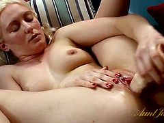 Soaking wet milf vagina opens up for a dildo