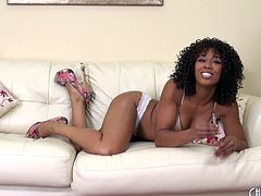 Sexy Misty Stone has a smoke then gives her pussy a poke