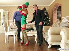 "Skinny teen Gina Gerson is a naughty elf in Private's ""Merry Christmas With the Family"". This young slut gets to work by dropping to her knees and giving a double deep throat blowjob! Gina Gerson has her tight teen body pounded from behind while sucking a big cock."
