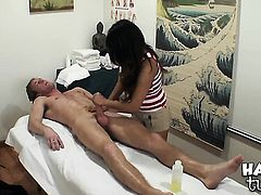Oriental Annie Lee with huge knockers and clean muff squeezes the cum out of rod with her pussy in interracial sex action