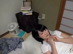 A cute Japanese girl was seduced by her master, while lying on the floor. The guy started pressing her boobs and sucked them. She was a bit shy at first, but then she started enjoying it. She licked his dick and enjoyed a memorable sex.