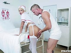Karol Lilien is a sexy blonde nurse and she gets her patients heartbeat racing by stripping down and showing him her young perky tits. This slut spends no time messing around, she lifts up her nurse uniform...